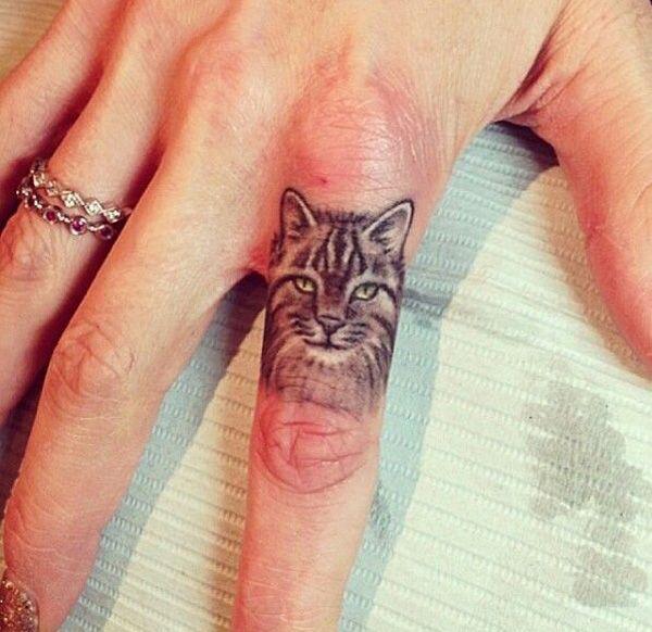 Cat Finger Tattoo