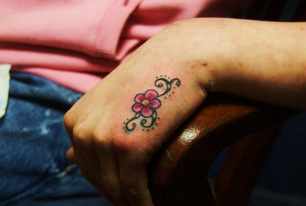 Tiny Daisy Tattoo