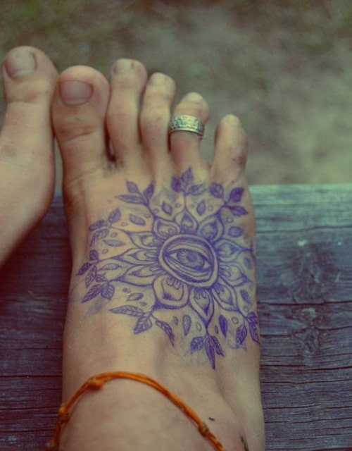 Eye Tattoo on Foot with Petals and Leaves