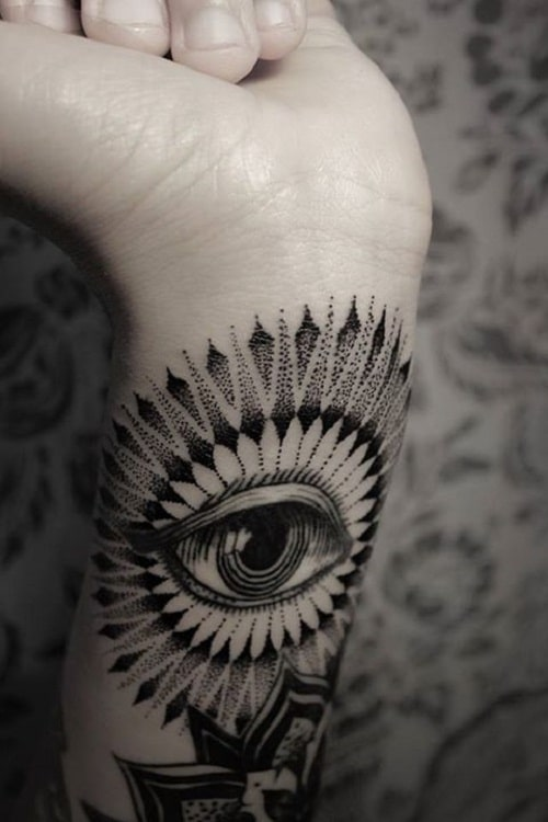 Flower with Eye on Middle Tattoo on Wrist