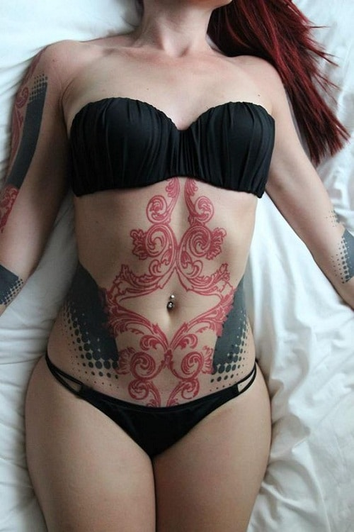 Red and Black Stomach Tattoo