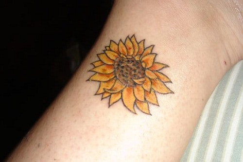 Small Sunflower on Wrist Tattoo