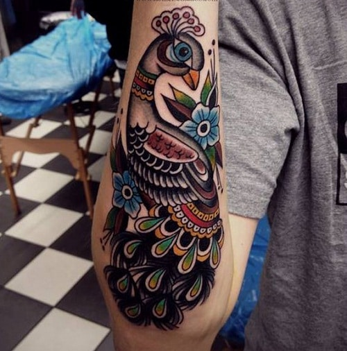 Colorful Peacock On Lower Arm Tattoo