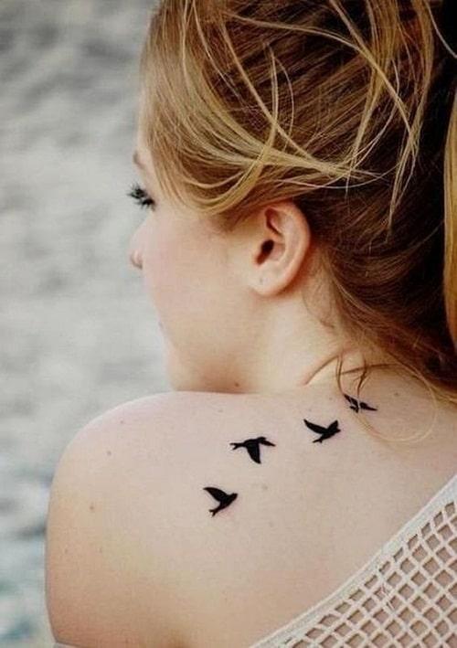 Impressive Black Back Dove Tattoos