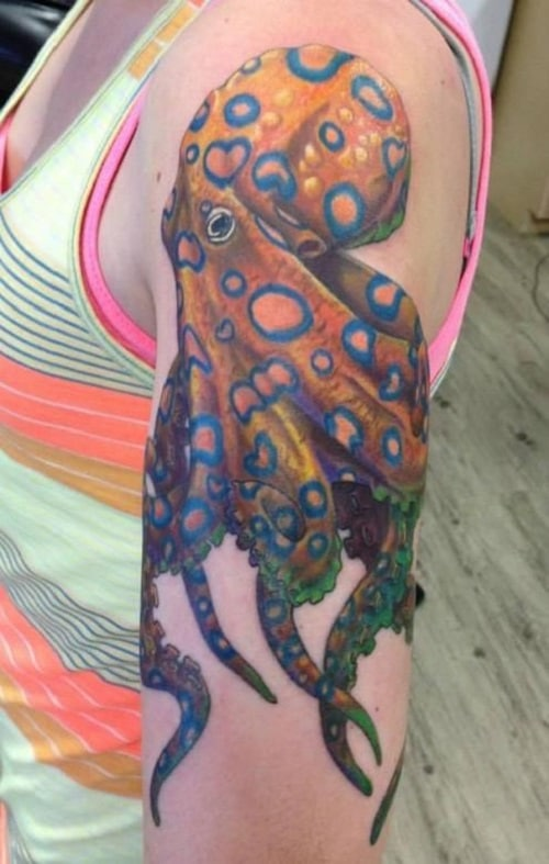 Orange Octopus Tattoo With Circular Designs