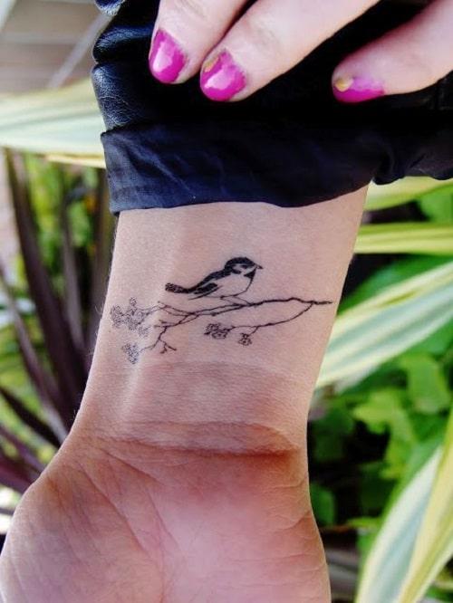 Bird Tattoo Sitting on a Branch Ideas