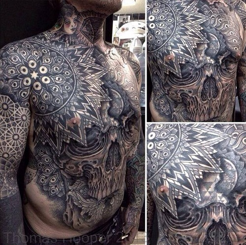 Black Outstanding Skull Tattoo on Stomach