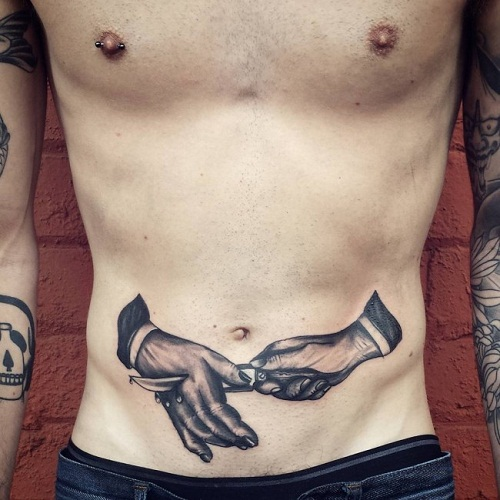 Stabbed Hand Stomach Tattoo