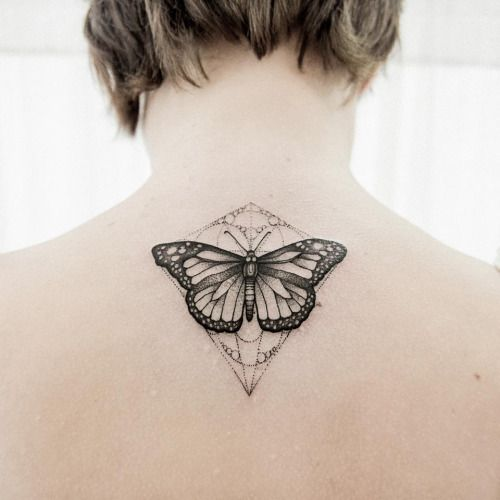 Black Butterfly with Geometric Lines on Back Tattoo