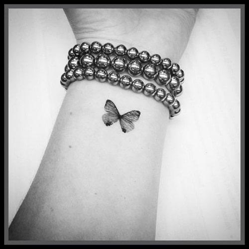 Black Wrist Butterfly Tattoo