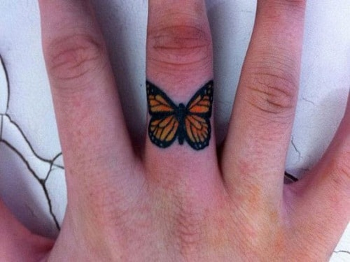 Orange Butterfly on Middle Finger Tattoo