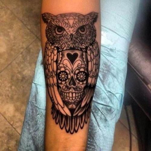 Owl Hugging a Skull Tattoo