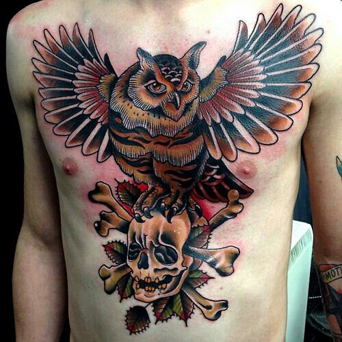 Owl on Chest Standing on a Skull Tattoo