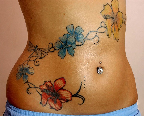 Belly Button Piercing And Hip Tattoo
