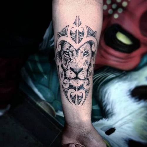 Small Lion Tattoo On Arm