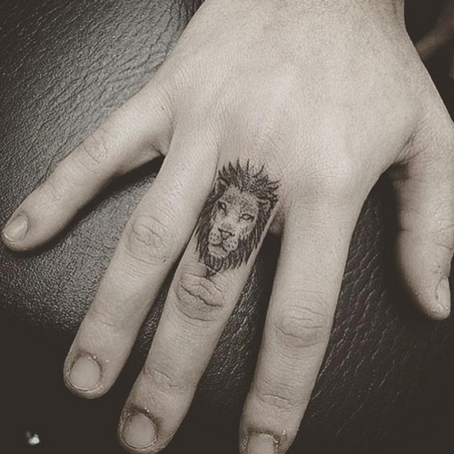 Small Lion Tattoo On Finger