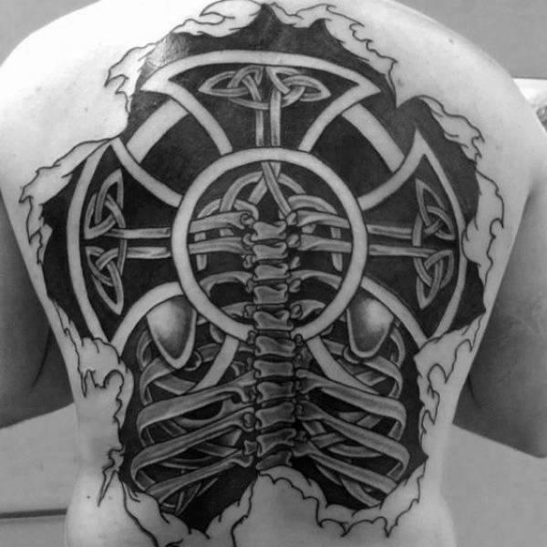 Cross Rib Tattoo