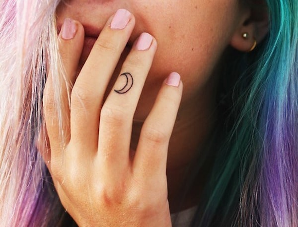 Crescent Moon Finger Tattoo