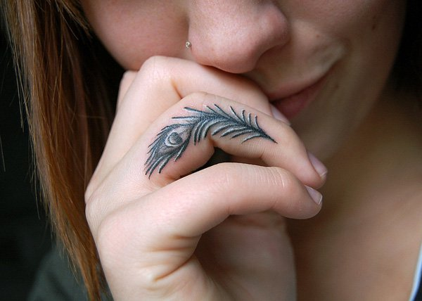Peacock Finger Tattoo