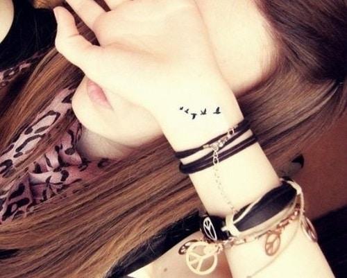 Extra Tiny Bird Tattoos on Wrist