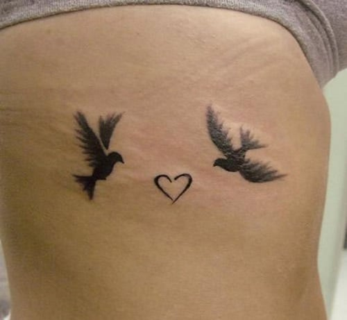 Lovebirds Flying Towards a Heart Tattoo