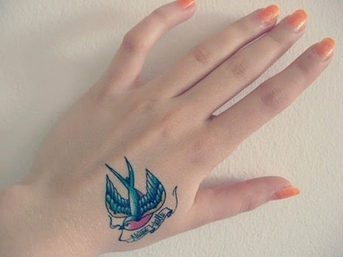 Beautiful Dove on Hand Tattoo