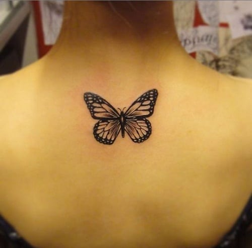 Black Upper Back Butterfly Tattoo