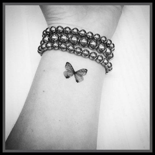 Black Wrist Butterfly Tattoo
