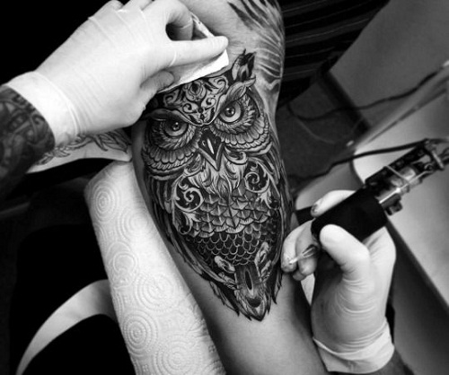 Detailed Serious Owl on Arm Tattoo