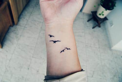 Flying Doves on Wrist Tattoo