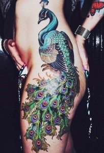 In Demand Peacock Tattoo On Side And Hips
