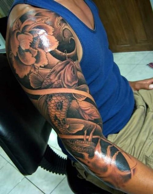 Koi Tattoo on Sleeve with Flower