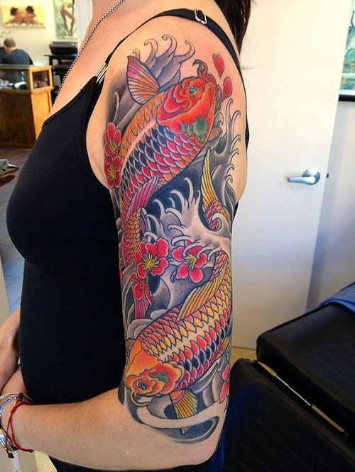 Koi Tattoos with Flowers and Waves