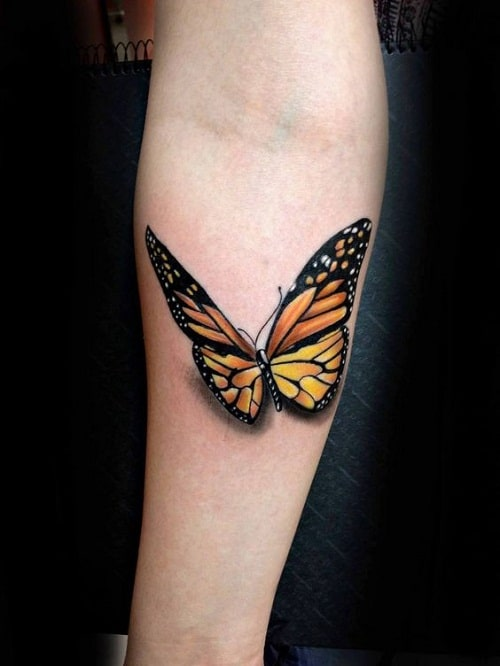 Orange and Black Butterfly on Lower Arm Tattoo